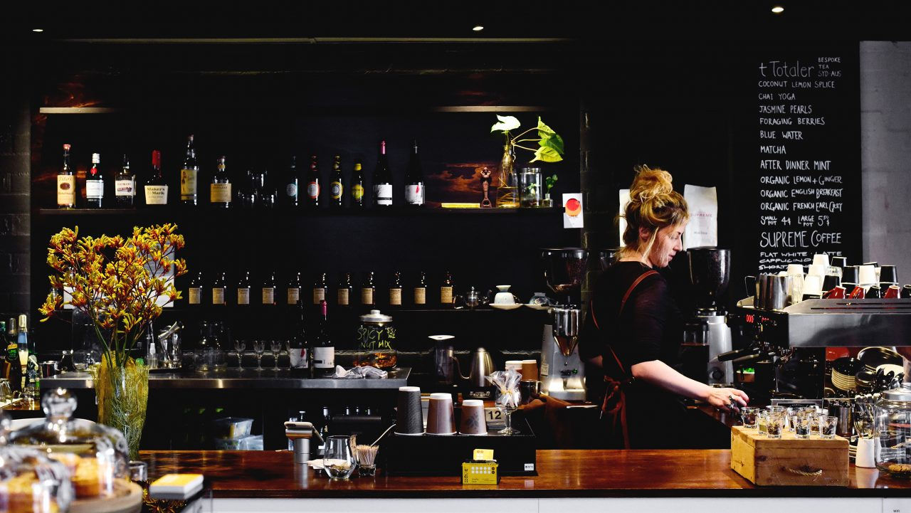 Woman making coffee at Hope on Boundary Street Café. Photography: Michael Carrello.